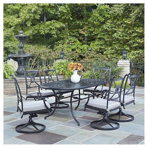 The Athens Cast Aluminum Outdoor collection by Home Styles is classic twist on a Greek inspired design. Mediterranean influences are apparent in the ornately turned table legs, intricately woven look of the cast aluminum top, and the shield circlet chair back design. The Athens Collection 7PC Dining Set by Home Styles contributes a Mediterranean style to any outdoor living space by displaying a hand applied antiqued charcoal finish. The ornate details provide a timeless flair while ...