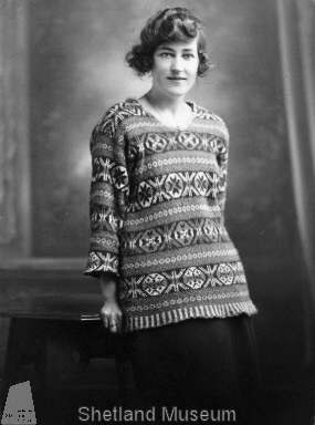 Woman, wearing Shetland patterned tunic style jumper with OXO patterning. Little is known about this photo apart from that it belonged to the donor's auntie, who was Cissie Gilbertson nee Inkster of Lerwick (1907-1968).