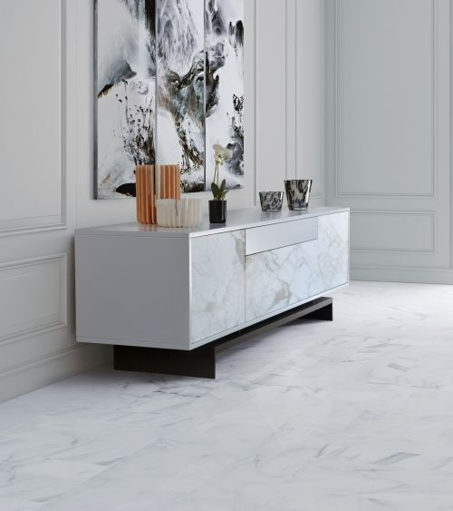 Grammi S sideboard is a balanced piece of furniture, combining the finest marble species with warm and cozy wooden finishes, which result is a luxurious element, full of attitude and class.