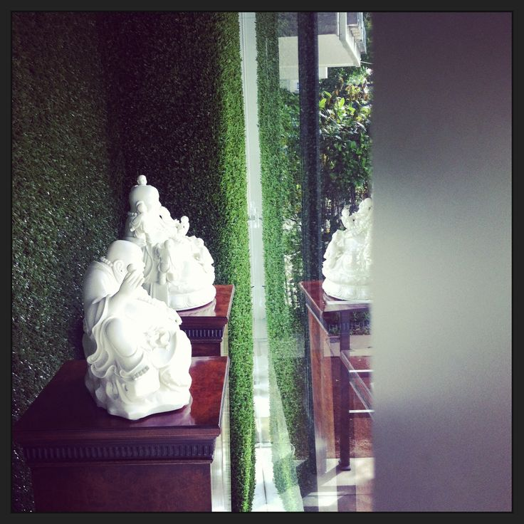 """the BUDDHAs..Fertility and Happy Buddha..you want them, we stock them :) #karageorgiou  Detail of our small window display, """"Always be blooming"""" May 2013"""