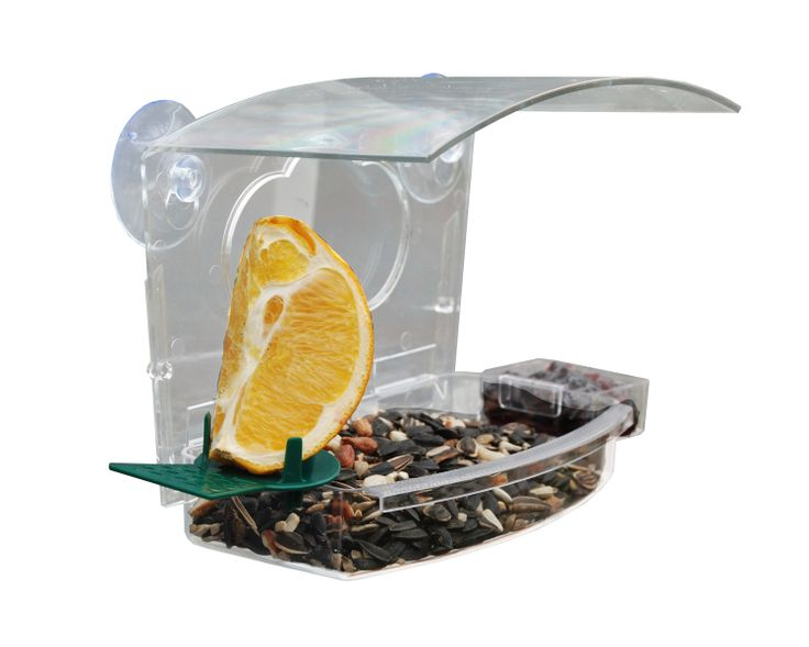 NAWFDR  Mixed treat window feeder  Attracts all kinds of birds! Sticks to glass surfaces and holds oranges, seed and jelly. Easy to fill and clean.