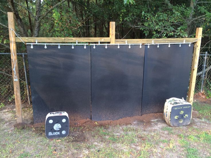 My arrow backstop that I finally finished! I started off with a 4x4 frame about 14 feet wide and 6 feet across. I used lead pipe and small fence clamps to hang three horse stall mats. Then just in case I ran the cable through the pipe, pulled tension and mounted them to rings for extra support. Definitely a 2 or 3 man job, but it's wide enough for my family of 4 to each person to set up a target. Now I'm just going to put up some lights so I can practice when I get home from work!