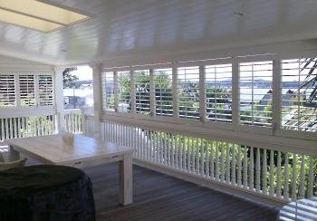 Heritage Bifolds Harbour View - Exterior Shutters | Santa Fe Shutters