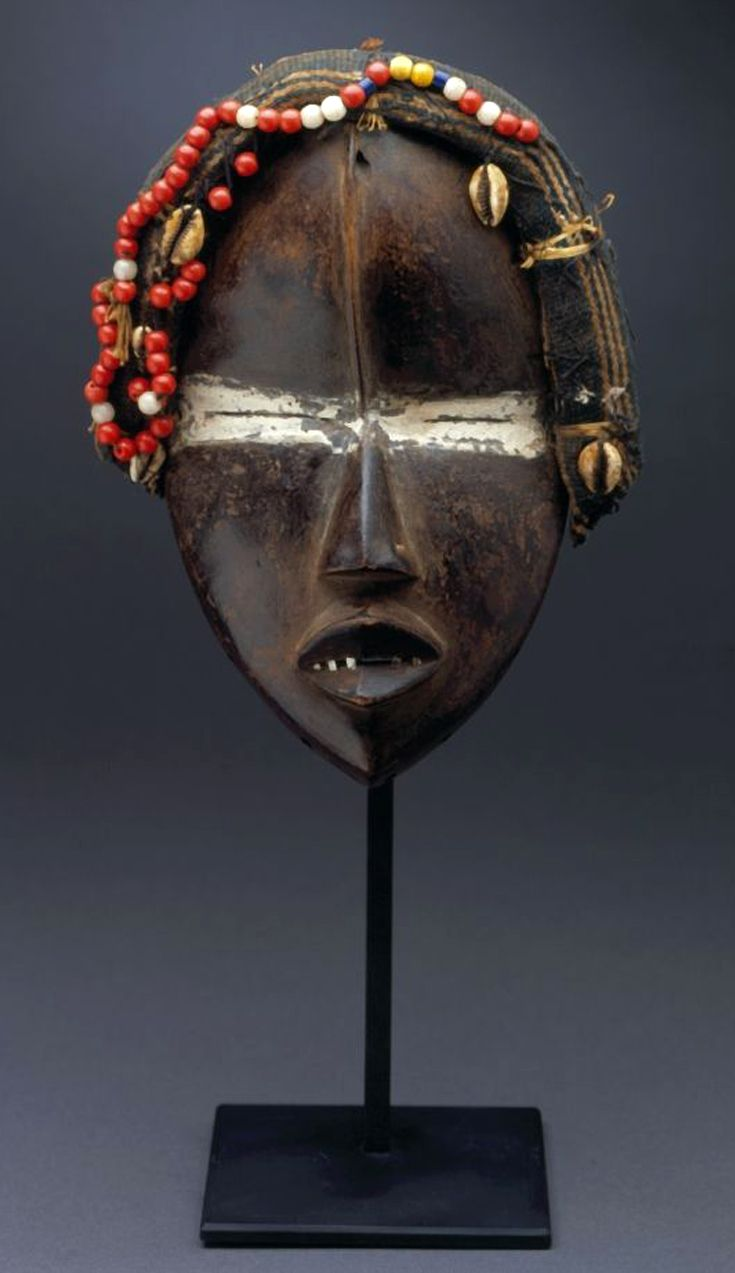 Africa   Face mask ~ deangle ~ from the Dan people   20th century   Wood, pigment, glass beads, shell and fiber.