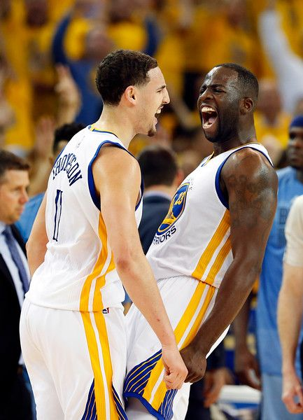 Description of . Golden State Warriors\' Klay Thompson (11) and Draymond Green (23) celebrate Thompson\'s 3-point basket against the Memphis Grizzlies in the fourth quarter of Game 5 of the Western Conference NBA semifinals at Oracle Arena in Oakland, Calif., on Wednesday, May 13, 2015. (Ray Chavez/Bay Area News Group)