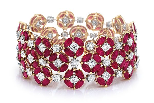 "Ruby and Diamond Bracelet - 3-row bracelet of marquise-shape rubies, in clusters of 4, forming circles with a round brilliant-cut diamond at each center, in a pattern with diamonds as connectors; in 18-karat rose gold. Dimensions: approx. 1"" wide x 6 5/8"" long. / Cellini Jewelers."