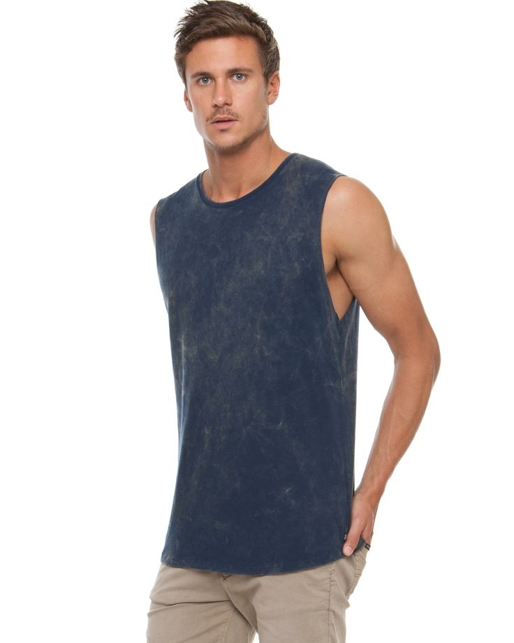 """100% cotton muscle tank. The Rusty Gravity Muscle tank has a finely ribbed, crew neckline and a sleeveless design with a raw finish. Made from 100% soft cotton, the muscle tank has a washed navy shade, and provides a regular fit.Length: 80cm.   Our model is wearing a size large tank. He is 6'3"""" (192cm) tall with a 39"""" (99cm) chest and a 32"""" (81cm) waist."""