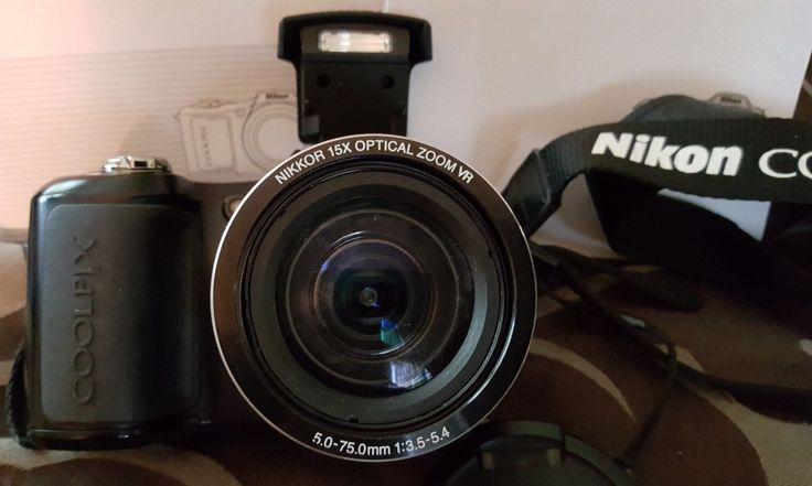 Nikon COOLPIX L100 10.0MP 15x zoom lens Digital Camera  Black  Works Great.