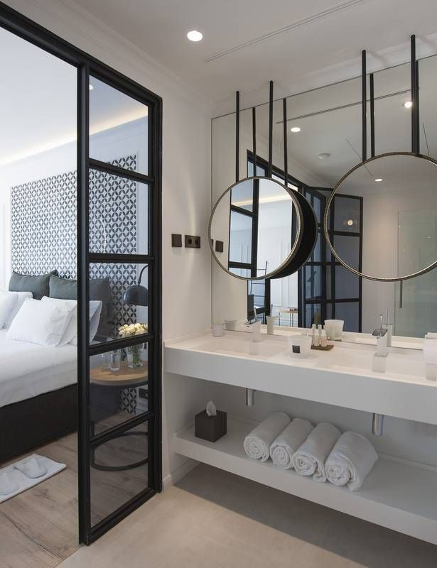 Love the tiled back headboard - 10 Tricks to Steal From Hotel Bathrooms floating vanity