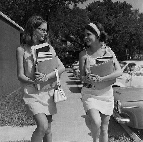 The long walk home with arms full of books. Life before backpacks!