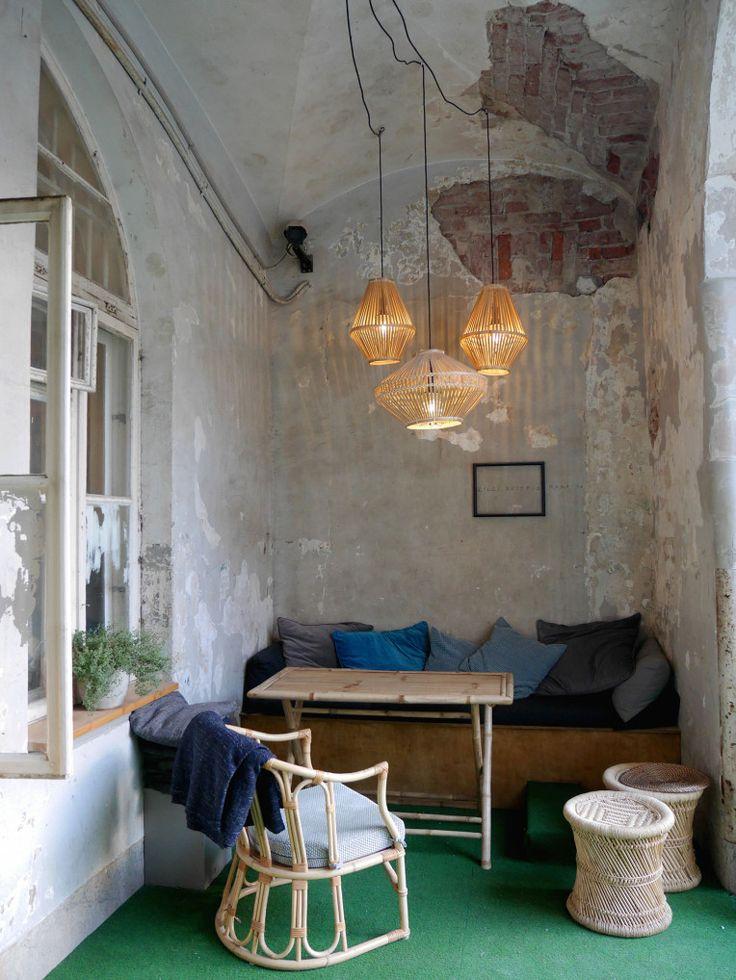 Urban interior design Sofa corner with lamps Restaurant interior Kakolanruusu, Kakola, Turku, Finland