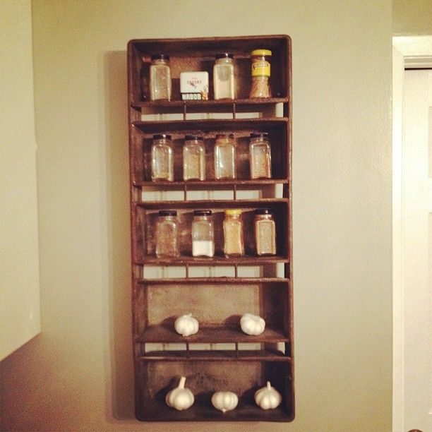 antique industrial bread tray turned spice rack