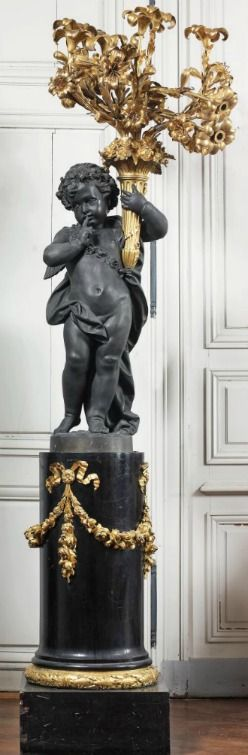 From Chateau de Degoine in Burgundy, France. Shown is one of the pair of gilt bronze cherub candelabra. Magnifique!