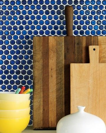 Go for a bold statement in your kitchen - how about a backsplash of cobalt penny tiles?