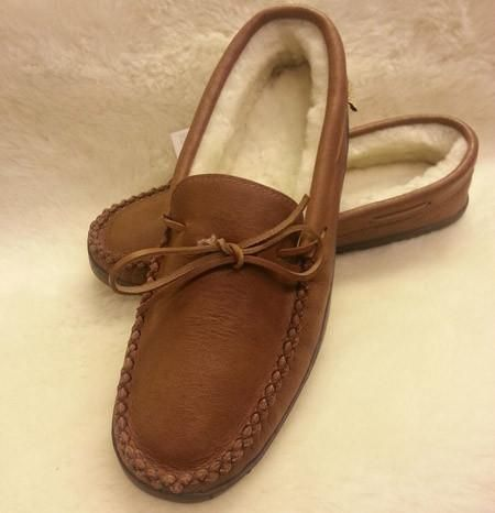Men's moosehide moccasin with 100% genuine sheepskin lining. Durable rubber sole. Proudly made in Canada by Laurentian Chief.