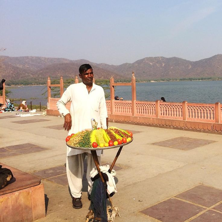 """It's afternoon chat time in Jaipur - a peaceful location here beside the Lake Palace, where kids…"""""""