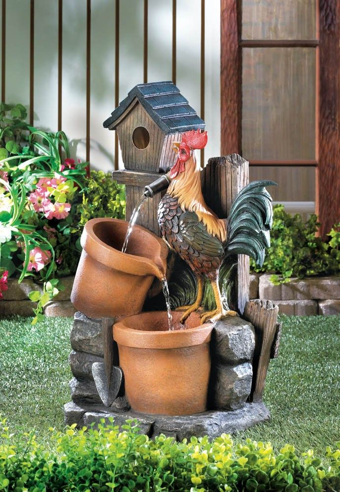 This charming water fountain will delight you and your guests. The stony backyard scene features a little birdhouse, two planters, and a strutting rooster waiting for a fresh drink of flowing water.