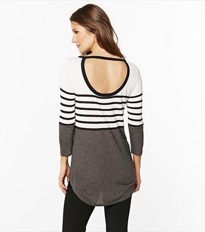 This striped tunic reveals a peek a boo sexy back.