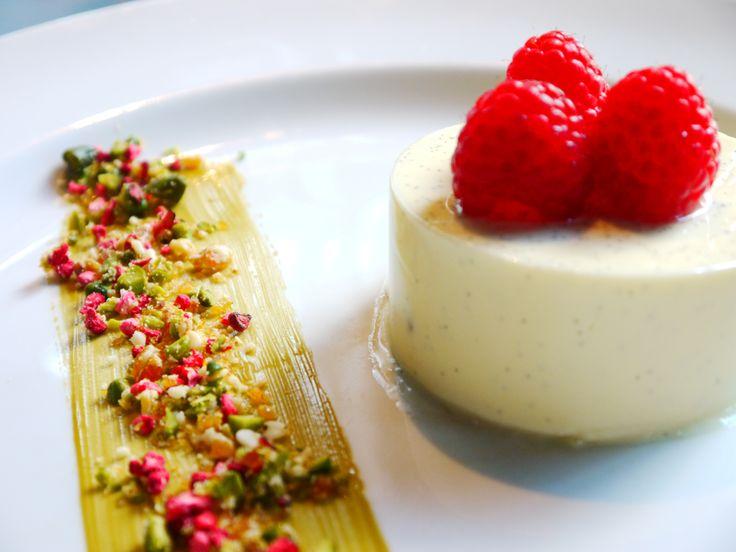 ... raspberries, vanilla panacotta with a raspberry and pistachio praline