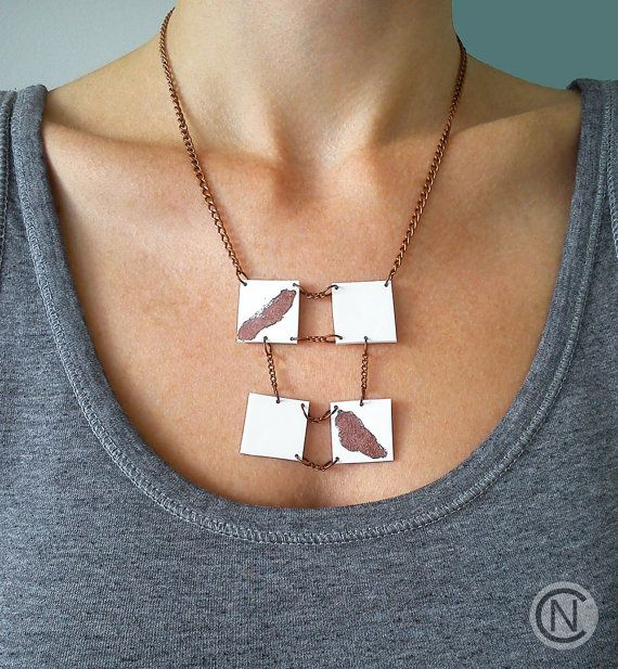 Handmade necklace with four white plastic pendants by NinaCamisi