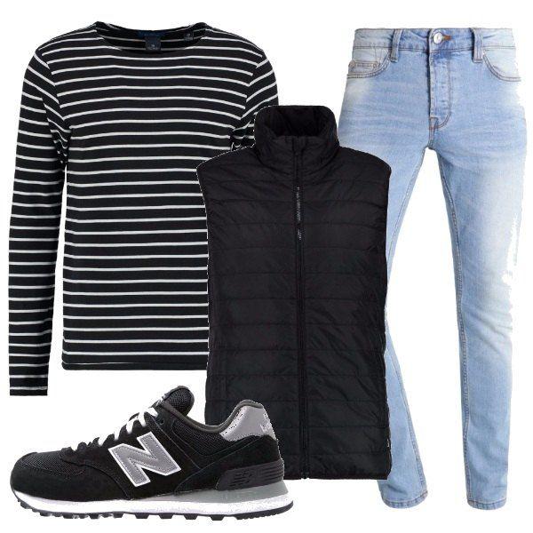 La maglietta maniche lunghe è tutta righe, abbinata ai jeans delavè alle scarpe sportive trendy e al gilet leggero ed imbottito, sportivamente moderno.