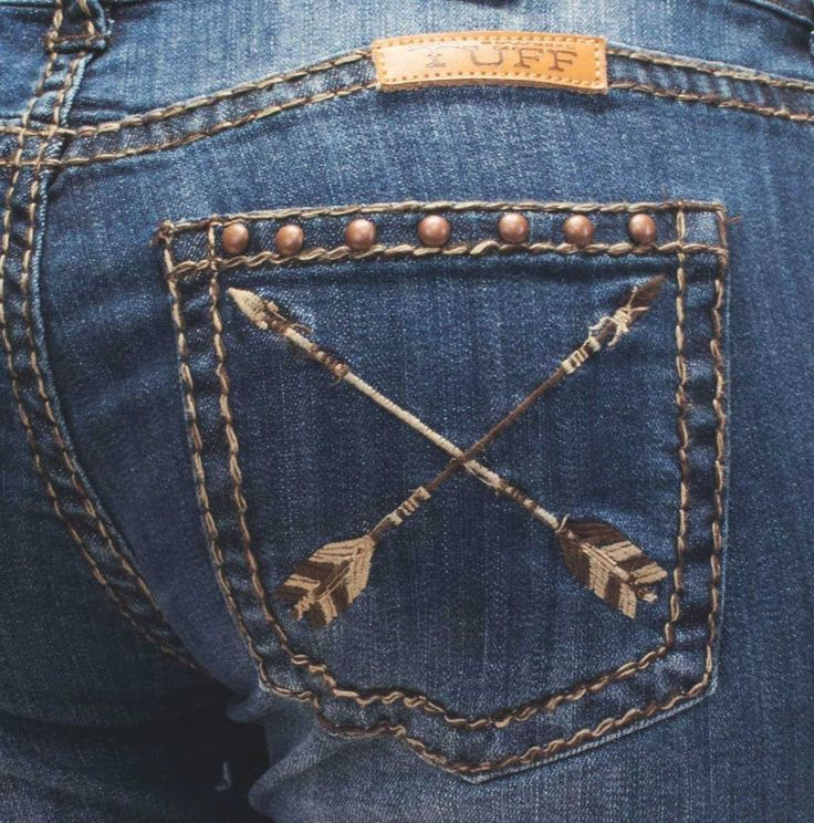 Arrow embroidery designs are the feature here! These women's Natural Pathmaker jeans by Cowgirl Tuff have unique arrow embroidery down the leg seams with stud accents, whiskering and distressing detai