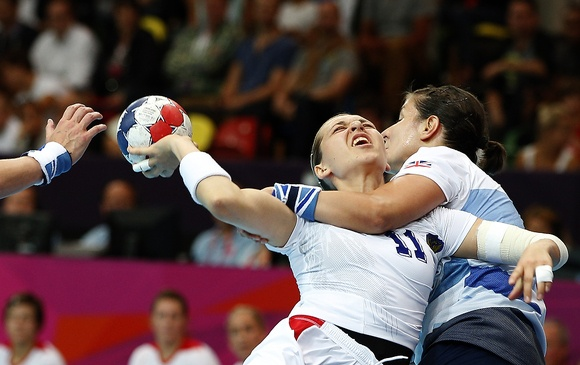Great Britain's Yvonne Leuthold, right, tackles Russia's Olga Levina, left, during their women's handball preliminary match at the 2012 Summer Olympics, Monday, July 30, 2012, in London. (AP Photo/Vadim Ghirda)