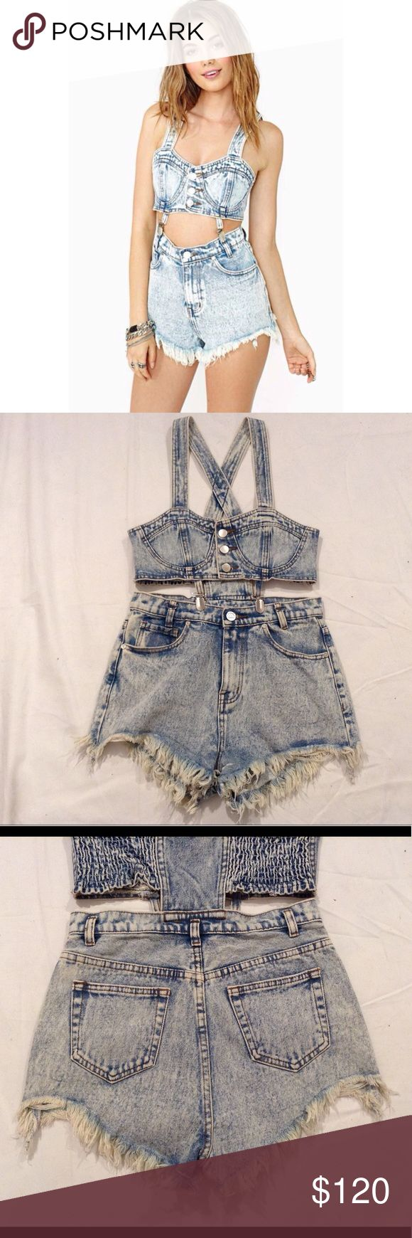 "UNIF Distressed Jean Shorts Bustier Bundy Jumper UNIF Jean jumper. Distressed/frayed jean shorts and bustier crop top. Suspender clips in front. Size M. Shorts waist measures approx. 14"" across laid flat. Stretchy elastic on the back of the bustier crop top. Worn once. Offers welcome! UNIF Dresses"