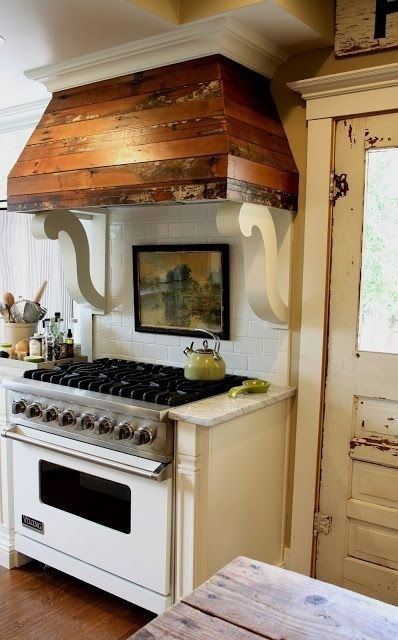 don't know about the scroll brackets but love the reclaimed wood hood.