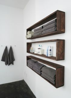 Maybe 2 and have towel hooks underneath- right beside the shower on that wall.  But need space for the bench underneath.