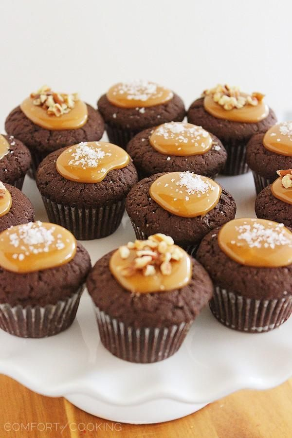 Salted Caramel Brownie Bites – Bake a batch of mini chocolaty Salted Caramel Brownie Bites for your next party! So easy, adorable and totally unique for a two-bite treat. Top them with what you like, but I'm partial to pecans and sea salt!| thecomfortofcooking.com