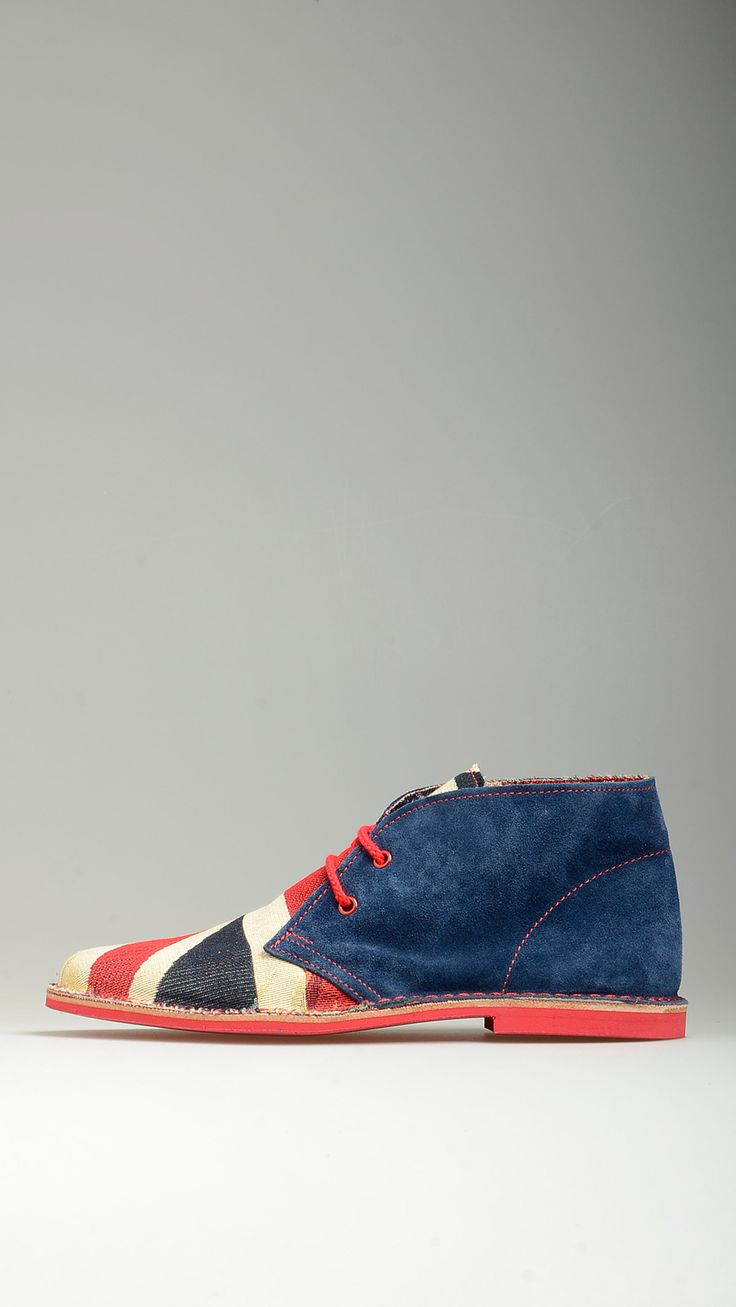 English flag uppers embellished dark blue suede lace-ups desert boots featuring contrast red cotton laces, desert boots manufacturing process, antioxidant eyelets, leather midsole, raw edge stitching, contrast red rubber sole, lining, 100�0finest suede and split grain leather.