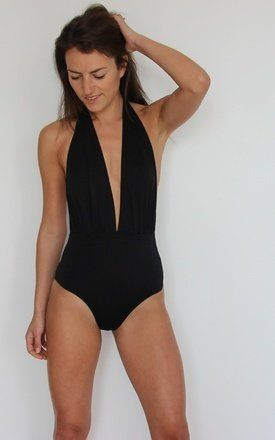 With its plunging neckline, this swimsuit brings a sexy twist to a timeless classic shape