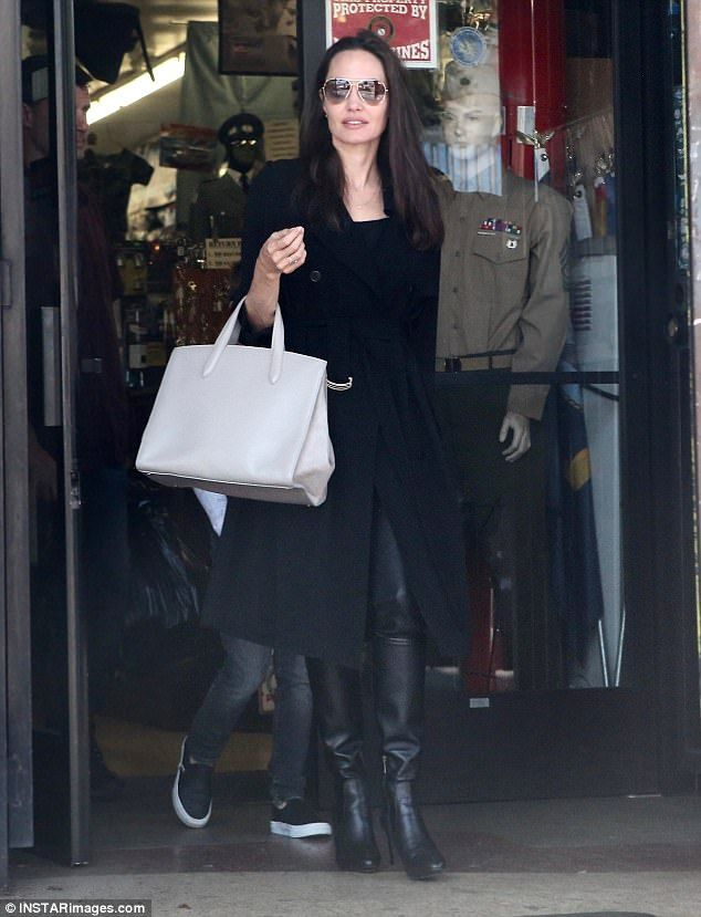 Keeping it simple: Sticking to her usual style, Angelina opted to wear all-black for the occasion and sported a light grey bag as her only pop of color