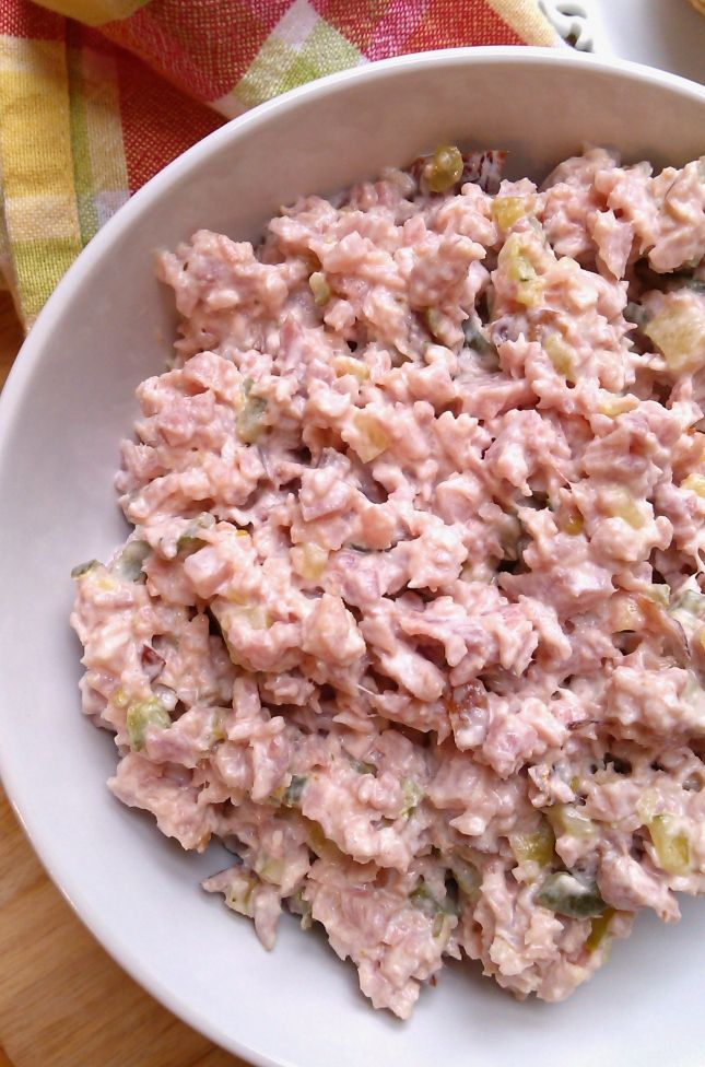 INGREDIENTS    1 lb.bologna  4 boiled eggs  3-4 sweet pickles  Salad dressing or mayo      Grind bologna,( I just diced it real small then take a fork and mash it the rest of the way) eggs and pickles. Mix together and add
