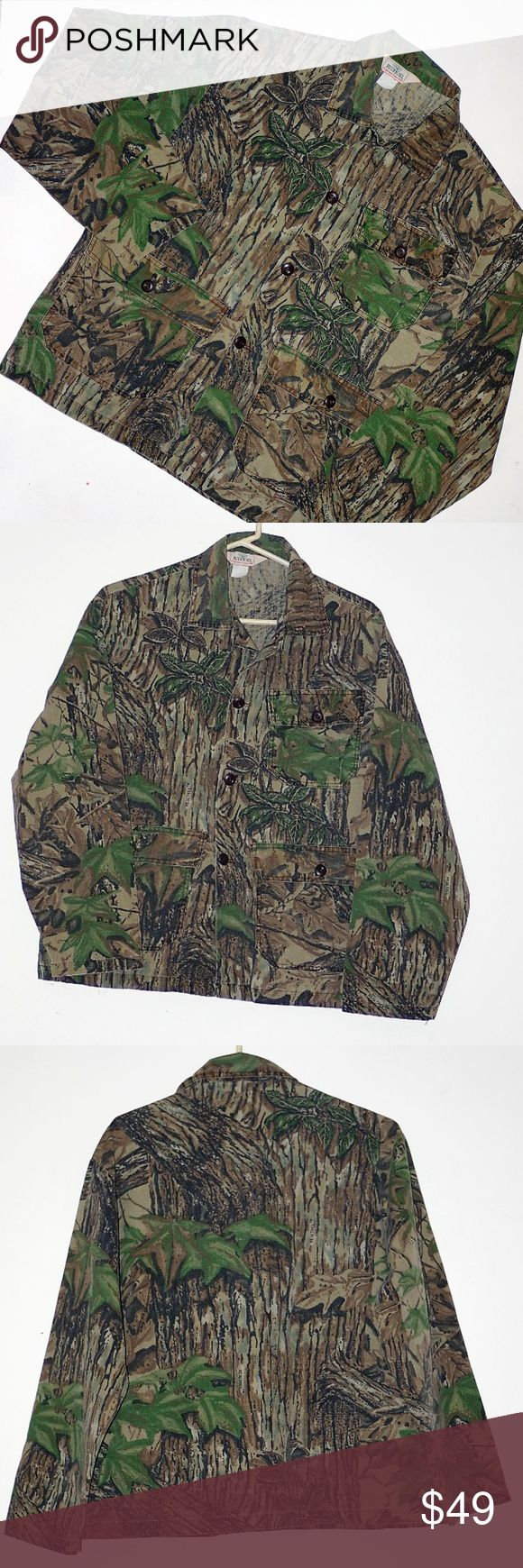 "Camo Shirt Jacket Realtree Vintage Redhead Women L Camo Shirt Jacket Realtree Vintage Redhead Women L By REDHEAD Realtree Graphics Camo Shirt Jacket Unisex  Mens Medium Womens Large Short Length 28"" Shoulders: 20"" Underarms seam to seam: 24"" Sleeve: Center shoulder seam to wrist: 23"" Vintage Pre Loved a bit of fading adds to it's charm Perfect for the Hunter or casual wear Vintage Redhead Jackets & Coats Jean Jackets"