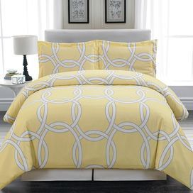 "Outfit your master suite or guest room in eye-catching style with this chic duvet set, featuring an interlocking ring motif.  Product: Full/Queen: 1 Full/Queen duvet and 2 standard shams King: 1 King duvet and 2 king shams Construction Material: PolyesterColor: YellowDimensions: Standard Sham: 20"" x 26""Full/Queen Duvet: King Sham: 20"" x 36""King Duvet:"