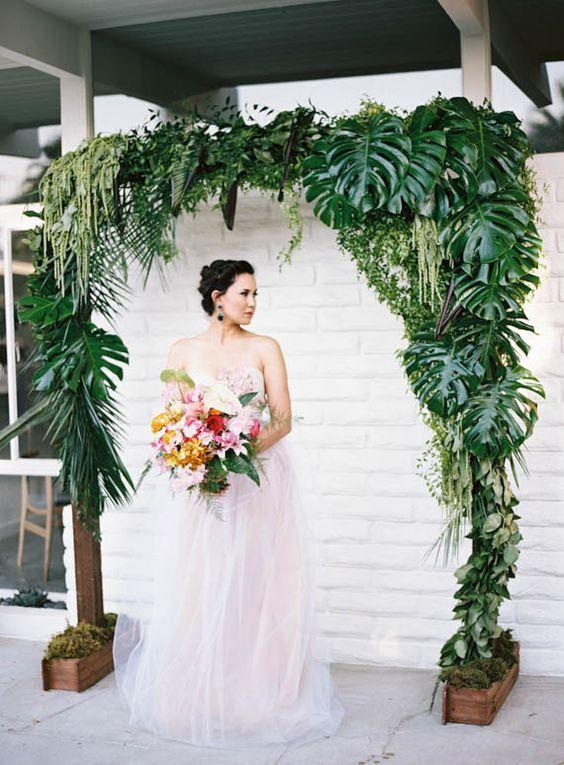 tropical green wedding arch / http://www.deerpearlflowers.com/tropical-leaf-greenery-wedding-decor-ideas/