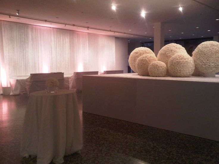 White crushed panne draping with dusty pink rose uplighting. Hardwall box to raise florals.