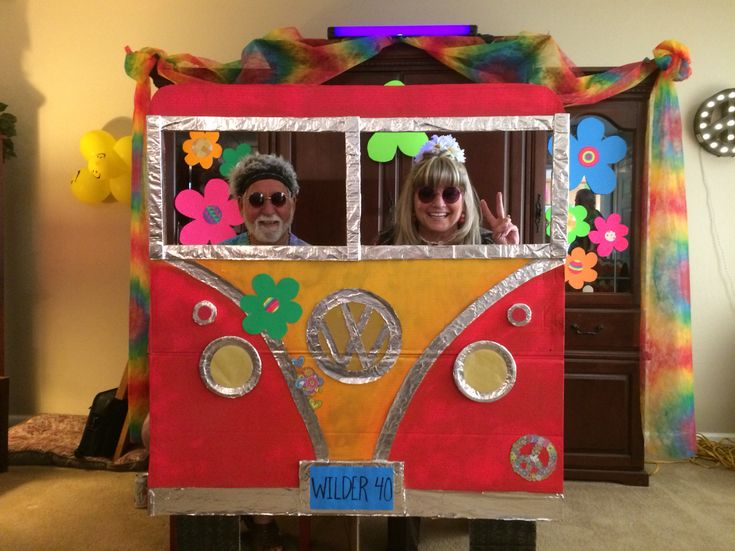 70's party vw bus photo booth!! Made with cardboard foil and spray paint!
