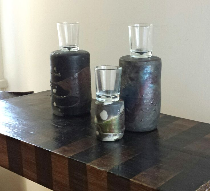 Pit-fired vases. My customer turned them into candleholders. I think they look great like this.