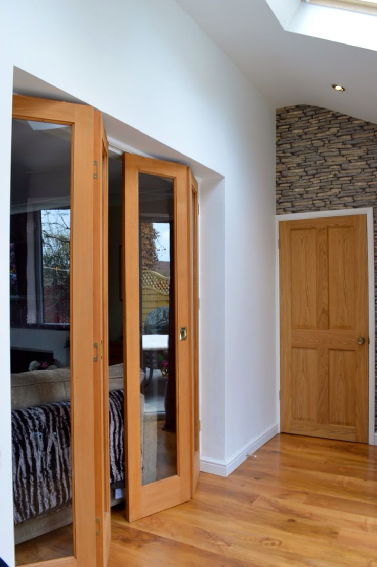 Double Bi Fold Hemlock U0027Pattern Fitted With Flush Finger Handles U0026 A 4 Panelled U0027Oak Londonu0027 Interior Door Completed In Moreton Wirral