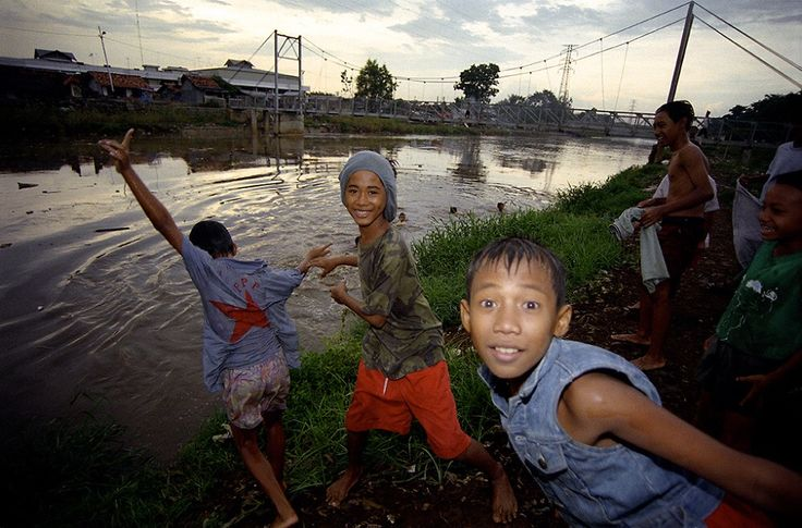 Boys swim in one of the polluted flood canals in central Jakarta Indonesia.
