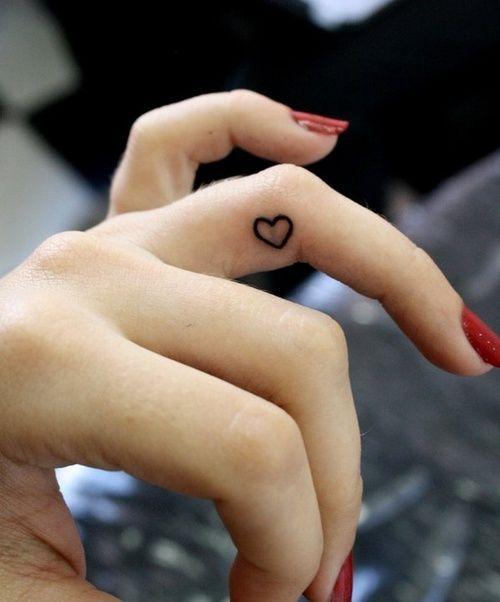 Tattoo / Little Heart on Finger / #tattoo #little #heart #line #ink #black #hand #finger #red #nails #hand
