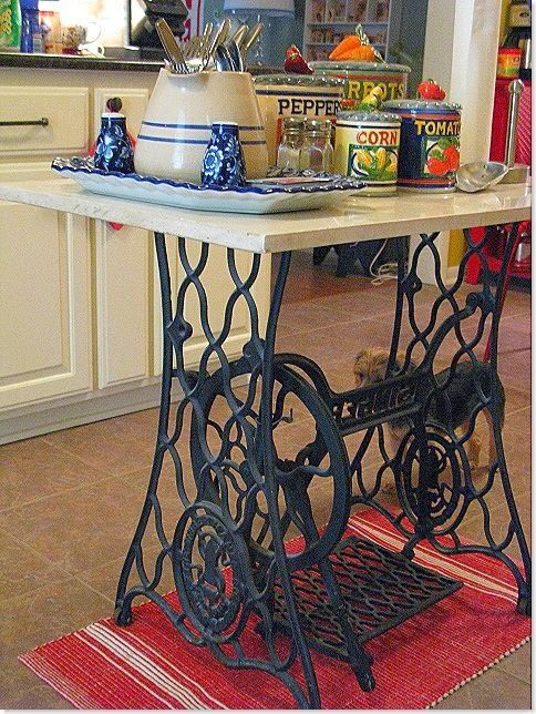 Good idea - i have an old sewing machine stand. repurposed metal and wood kitchen islands -