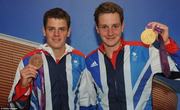 Proud: Jonathan Brownlee with his Bronze medal, left, and Alistair Brownlee with his Gold medal of Great Britain visit TeamGB House