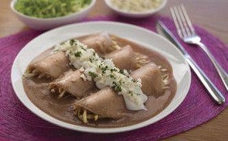 """Mexican food, chicken enfrijoladas better known as """"Enfrijoladas de pollo""""."""