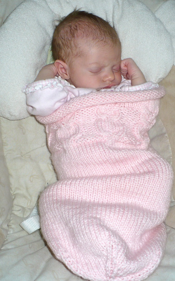 Knitted Baby Cocoon with matching hat.  I know I could make these.  Anyone need one?