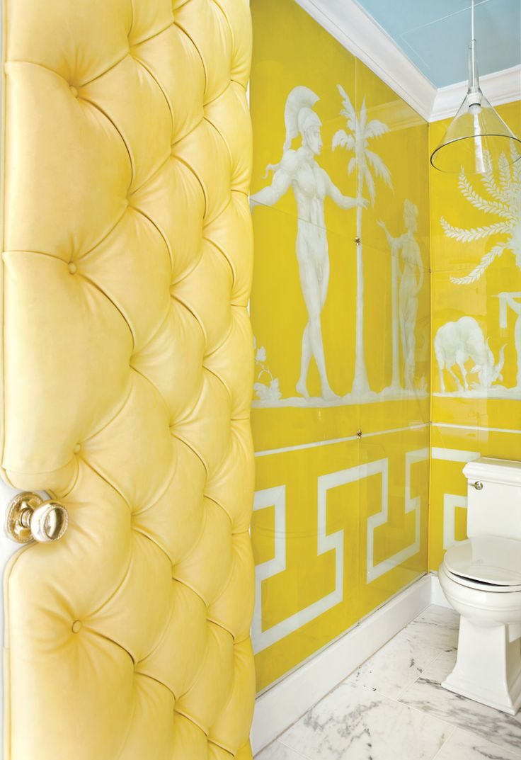 raymond goins canary yellow bathroom with blue ceiling canary yellow tufted door marble tiles floor and glossy yellow greek key wallpaper