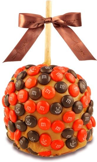 our halloween caramel candy apples are dipped in caramel enrobed in festive orange and coated in chocolate candies order them for your halloween party - Caramel Apple Ideas Halloween